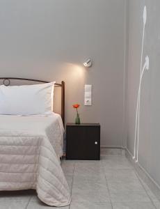 Ένα ή περισσότερα κρεβάτια σε δωμάτιο στο Almyra Studios