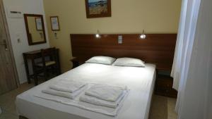 Un ou plusieurs lits dans un hébergement de l'établissement Eleni Rooms