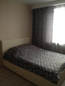 Кровать или кровати в номере апартамент у Роял Марин