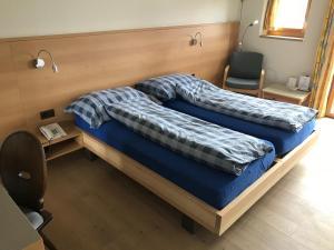 Кровать или кровати в номере Hotel Restaurant Kulm