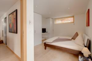 Ein Bett oder Betten in einem Zimmer der Unterkunft Apartment Meric Superior