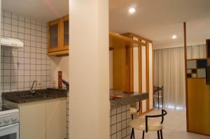 A cozinha ou cozinha compacta de Bristol Guarapari Residence
