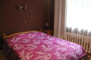 Letto o letti in una camera di Mamma Mia Holiday House
