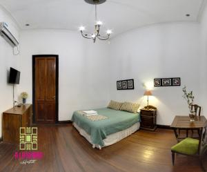 A bed or beds in a room at A la Gurda