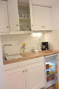 A kitchen or kitchenette at Agapi Suites