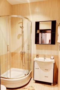 Ванная комната в Alfa Hotel
