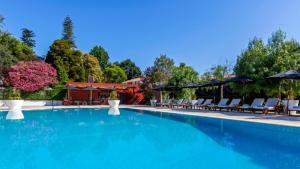 The swimming pool at or close to Hotel Quinta das Lagrimas - Small Luxury Hotels