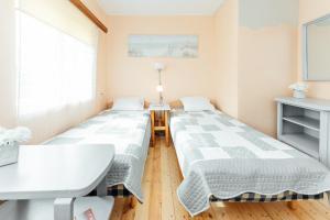 Voodi või voodid majutusasutuse Laterna Accommodation toas