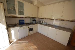 A kitchen or kitchenette at Apartamento Patel