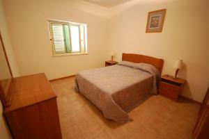 A bed or beds in a room at Apartamento Patel