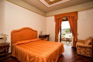 Letto o letti in una camera di Hotel Tritone Lipari