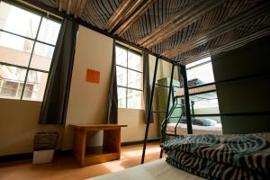 A bed or beds in a room at Melbourne City Backpackers