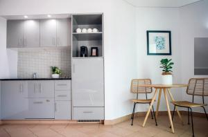 A kitchen or kitchenette at Port Douglas Peninsula Boutique Hotel - Adults Only Haven