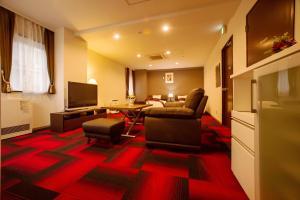A seating area at Condominium Stella Site
