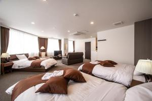 A bed or beds in a room at Condominium Stella Site