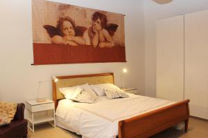 A bed or beds in a room at B&B Katerine