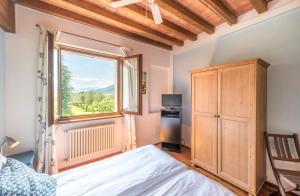Een bed of bedden in een kamer bij Agriturismo Cà Del Lago