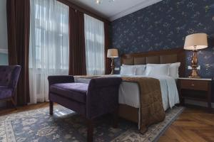 A bed or beds in a room at Esplanade Prague