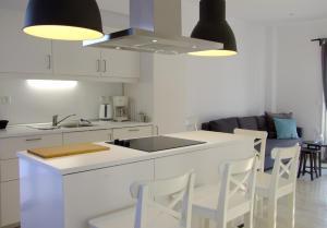 A kitchen or kitchenette at Helios Studios & Apartments