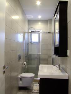 A bathroom at Helios Studios & Apartments