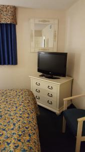 A television and/or entertainment center at JeffsCondos - 3 Bedroom - Breakers Resort