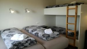 A bunk bed or bunk beds in a room at Guesthouse Storu-Laugar