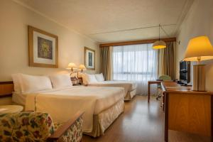 A television and/or entertainment centre at Maksoud Plaza Hotel Distributed by Accorhotels