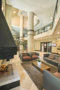 The lobby or reception area at Swan Caxias do Sul