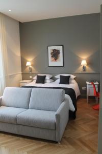 Un ou plusieurs lits dans un hébergement de l'établissement Villa Élyane