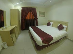 Cama ou camas em um quarto em Masat Al Badr Furnished Apartments