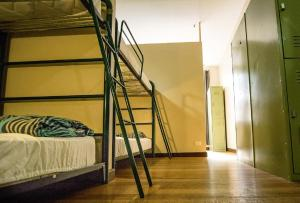 A bunk bed or bunk beds in a room at Melbourne City Backpackers