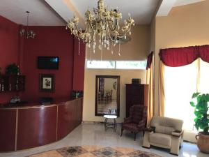 The lobby or reception area at Zion CassaRoyale Hotel