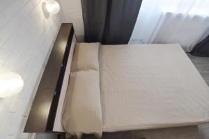 Кровать или кровати в номере Апартаменты на Московской