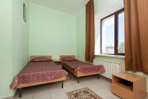 Кровать или кровати в номере Отель Регина Болгар