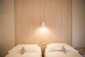 A bed or beds in a room at Hotel Delle Nazioni