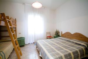 Postel nebo postele na pokoji v ubytování Condominio Brionetta