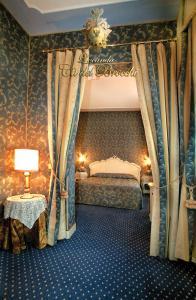 Кровать или кровати в номере Locanda Ca' del Brocchi