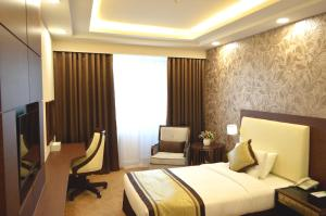 A bed or beds in a room at Bayangol Hotel