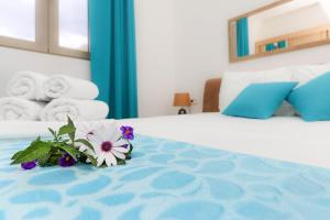 A bed or beds in a room at Apartments Castello