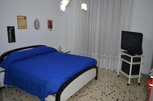 A bed or beds in a room at B&B Da Fiore
