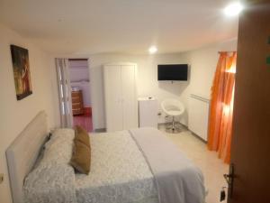A bed or beds in a room at Il Mirto E La Rosa