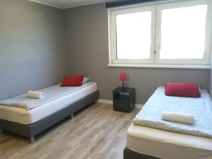 Łóżko lub łóżka w pokoju w obiekcie Tetris Sopot