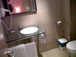 A bathroom at PLAYA Santa Baia