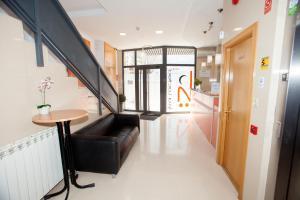 The lobby or reception area at Hostal Via Láctea