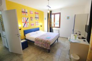 Een bed of bedden in een kamer bij Rosso di Sera