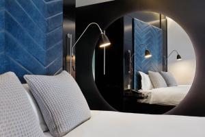 Un ou plusieurs lits dans un hébergement de l'établissement The Hoxton, Shoreditch