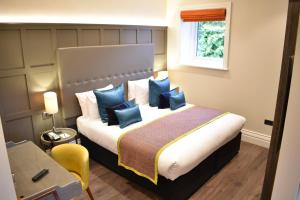 A bed or beds in a room at The Hermitage Hotel - OCEANA COLLECTION