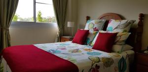 A bed or beds in a room at Hay Point Country BnB