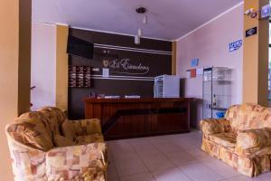 The lobby or reception area at Hostal el Escudero