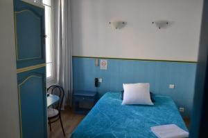 Un ou plusieurs lits dans un hébergement de l'établissement Hotel Durand Le Patio